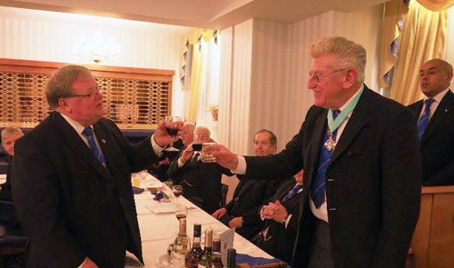 Harry Waggett (left) toasting Martyn Jones.