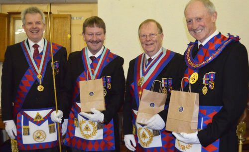 Pictured from left to right, are: Stuart Boyd presenting the traditional Eccles cakes to Paul Hesketh, Colin Rowling and Barry Jameson.