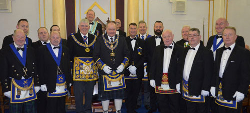Pictured centre from left to right, are: Tony Harrison, Gordon Currie Fisher and Harold Smith with the brethren of Lodge Kenmuir.