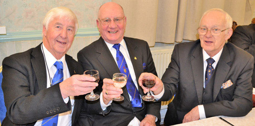Toasting John Heaton's health (pictured right) are: Jim Wilson (left) and David Grainger (centre).