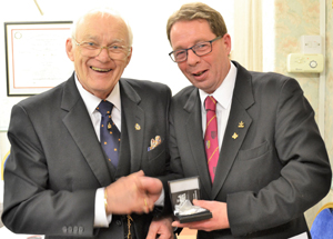 David Tattersall (right) presenting John Heaton with his pocket watch, a gift from the brethren of Runic Lodge.