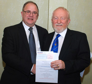 Bernard Snape (right) gratefully accepts a cheque from Andrew Keith on behalf of Wyrebank.