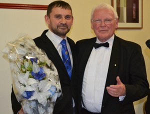 Dave Thomas (left) receives a bouquet of flowers from Gordon Brown, for his wife, along with a big thank you for his attendance at the installation.