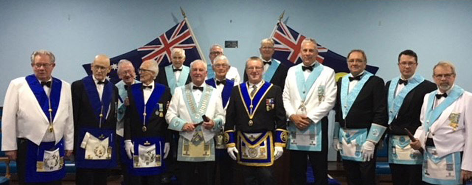 Pictured with Peter Whaley (centre right), are the WM Dennis Lamb (centre left) and the brethren of Seaview Lodge.
