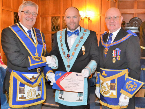 Pictured from left to right at the presentation of the 'Patron of the MCF 2021 Festival' certificate are: Regional Charity Steward Geoff Bury, Carl Horrax and David Grainger.