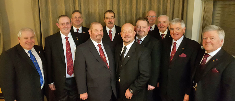 An impromptu photo call with Glenn (centre) surrounded by various grand and acting Provincial grand officers.