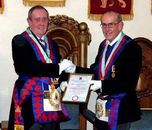Tony Hall (left) presenting Brian Fairhurst with his jubilee certificate.
