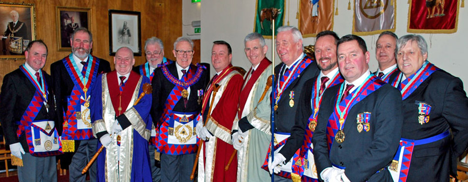 Pictured centre from left to right, are: Ian Tupling, Ian Higham, Mike Sheron and Peter Hoyles, with the grand and acting Provincial grand officers.