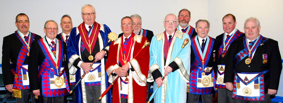 Pictured front row from left to right,, are:  Ian Cuerden, Simon Gray, Michael Clarke and Allan Hore with the grand and acting Provincial grand officers.