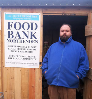 Ezra outside the Food Bank.