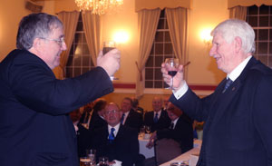 Peter Whalley (left) toasts Norman during the Master's Song.