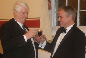 Norman Pritchard (left) toasts Barry Corcoran during the master's song.