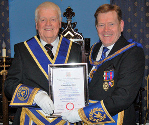 Tom Makin (left) receives his certificate from Kevin Poynton.