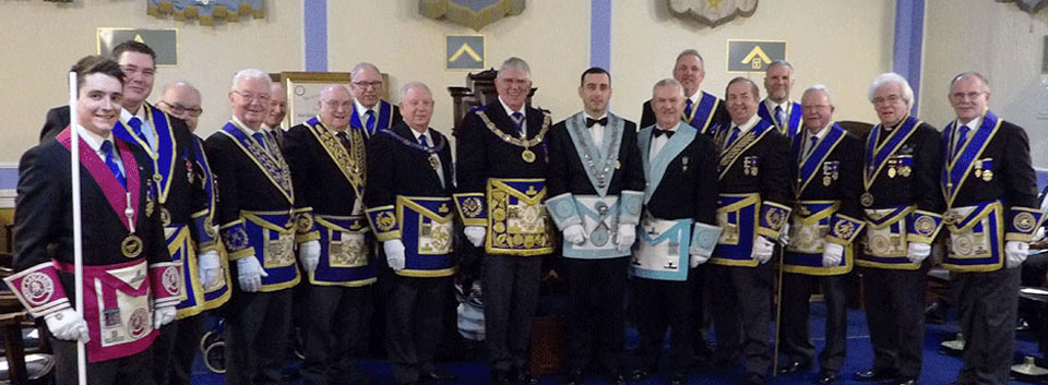 Grand officers and acting Provincial grand officers with the new master Marin Sirbu and the installing master Michael Thorne-Hebson.