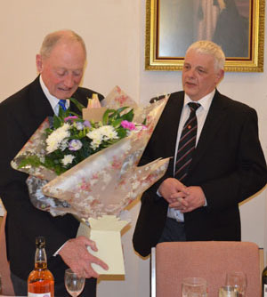 Paul (right) presenting Barry with a bouquet for his good lady.