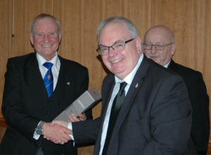Lawrence (centre) presents Dave with a fine whiskey watched by Jeff Winstanley.