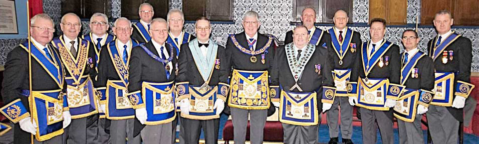 Grand officers, acting Provincial grand officers and the Garston Group executive join, (front row left to right), Derek Parkinson, Phi Hudson, Tony Harrison and Brian McNulty.