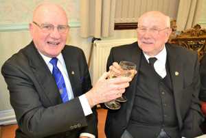 A toast to John Altham (right) from David Grainger.