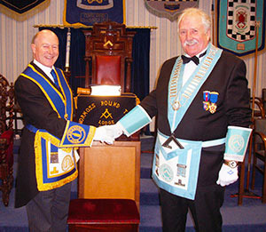 Peter Allen (left) congratulates Alan Berwick, the master of Normoss Round Table Lodge.