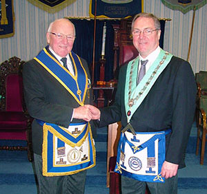 Ron Senior (left) congratulates Brian Coulter, the new master of Wayfarers Lodge.