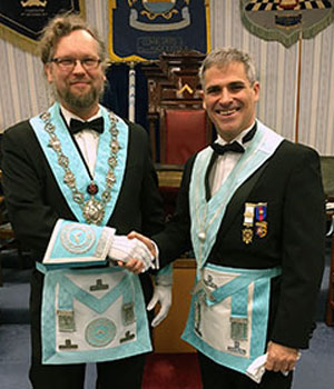 Newly-installed master of the Lodge David Edwards (left) is congratulated by the immediate past master Paul Darlington.