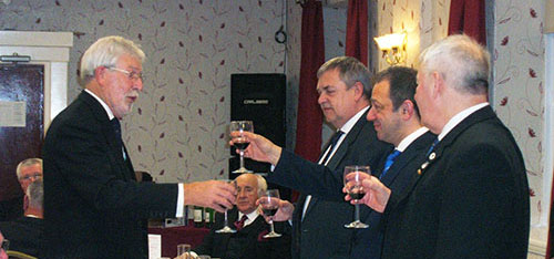 John Chesters toasts the three principals.