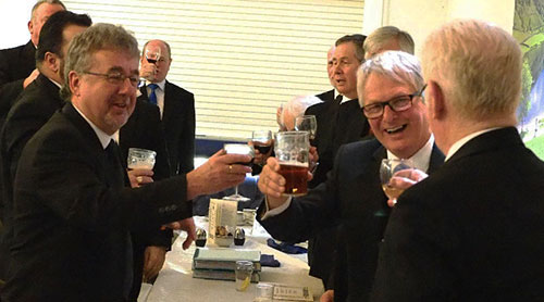 Hugh Mett (left) toasting Warren Yates at the conclusion of the master's song.