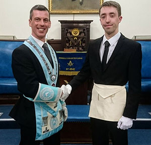 WM Richard Gillett welcomes his son Adam into the lodge.
