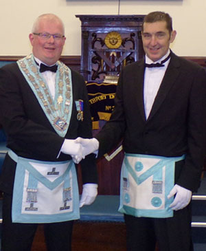 Outgoing WM Steve Cullen (left) welcomes Alan Proctor.