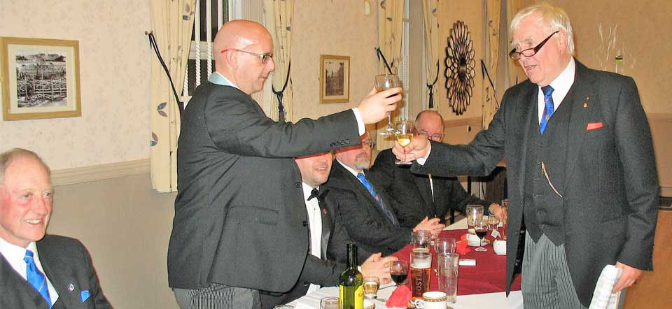 John Hutton (right) toasts Ian with the master's song.