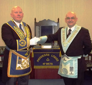 Malcolm Bell (left) congratulates Mark Rollins on attaining the chair of Prodesse Lodge.