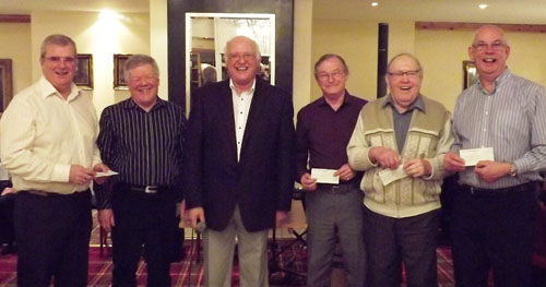 Dividing the proceeds. Pictured from left to right, are: John Selley, Chris Reeman, David Ogden, Pete Kelly, Ernest Lloyd and David Whitmore.