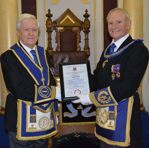 Dave Walmsley (right) presents Brian with his 50 year certificate.
