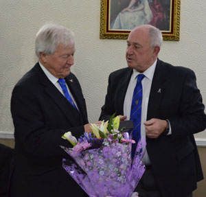 Phil Evans (right) presents a bouquet and pen set to Brian on behalf of the lodge.