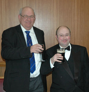 Phillip (left) taking a toast with Nick.