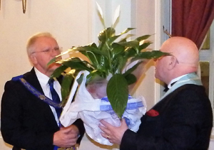 Ian Elsby (right) presents 'Peace Lily' to Derek Parkinson.