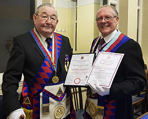 David Scattergood (left) is presented with not one but two certificates to mark his anniversary, by Ian Cuerden.