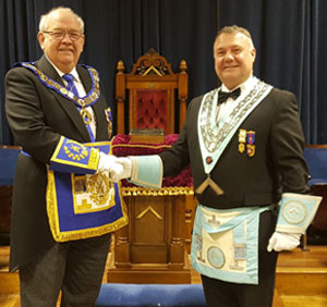 Paul Hook (right) is congratulated on his installation by Philip Gunning.
