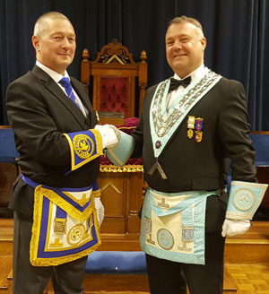 Installing master Garry Bryon (left) hands over the reins to Paul Hook.