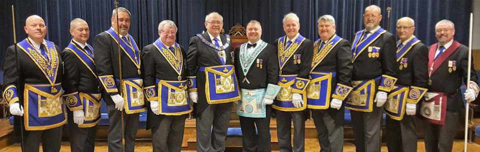 Paul Hook (centre) with Deputy Provincial Grand Master Philip Gunning, together with Leigh Group Chairman Len Hart, vice chairman Joe Hine, grand officers and acting Provincial grand officers.