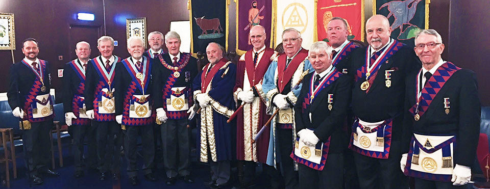 The three principals accompanied by distinguished grand and acting Provincial grand officers.