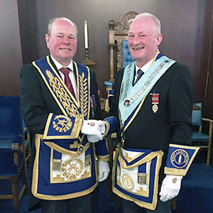 Duncan Smith (left) congratulates Damon Tait, new master of Mount Lodge.