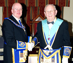 Robert Wright (left) congratulating Francis Aspinall on becoming WM.