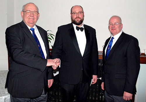 Philip Gunning (left) congratulating Martyn Huyton-Berry on his becoming WM, with Robert Wright (right).