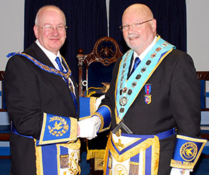 Robert Wright (left) congratulates new master, Mike Melia.
