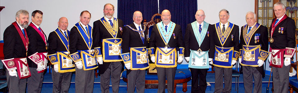 Robert Wright and Mike Melia (centre), with grand and acting Provincial grand officers.