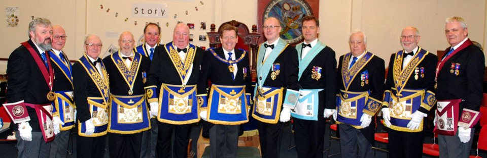 Pictured are: Kevin Poynton and Timothy Gerrard (centre), with the grand and acting Provincial grand officers.