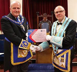 John Clulow (right) receiving an MCF 2021 Festival Patron's certificate from David Winder.