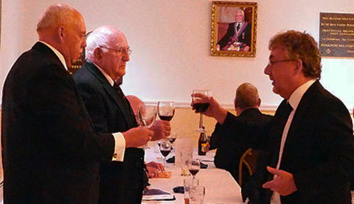 Hugh Mett (right) concludes the principal's song with Mike Lumby and Ray Boardman receiving the toast.