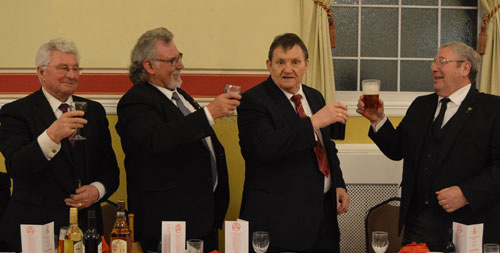 Pictured from left to right, are: Eric Delamere, Gary Oates and Samuel Boardman being toasted by Dave Tabron.